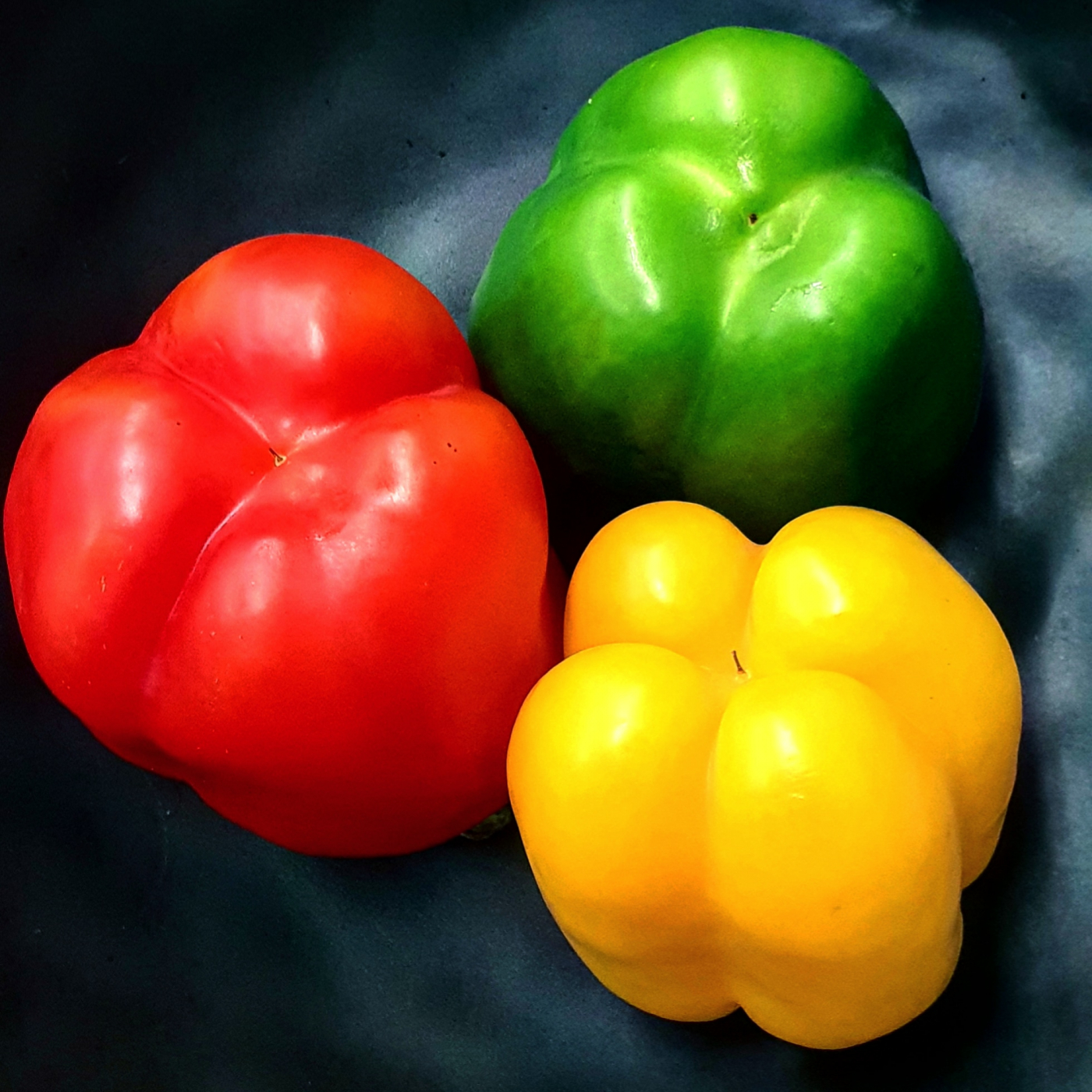 The bell pepper is the fruit of plants in the Grossum cultivar group of the species Capsicum annuum.       Bell peppers originated in Mexico, Central America, and South America.  red, green, yellow and orange bell peppers are all the same type of pepper but just at different stages of ripeness. Green peppers are unripe, red are fully ripe, with yellow and orange in between the two.  We use them in our 'Cauliflower Manchurian' recipe.