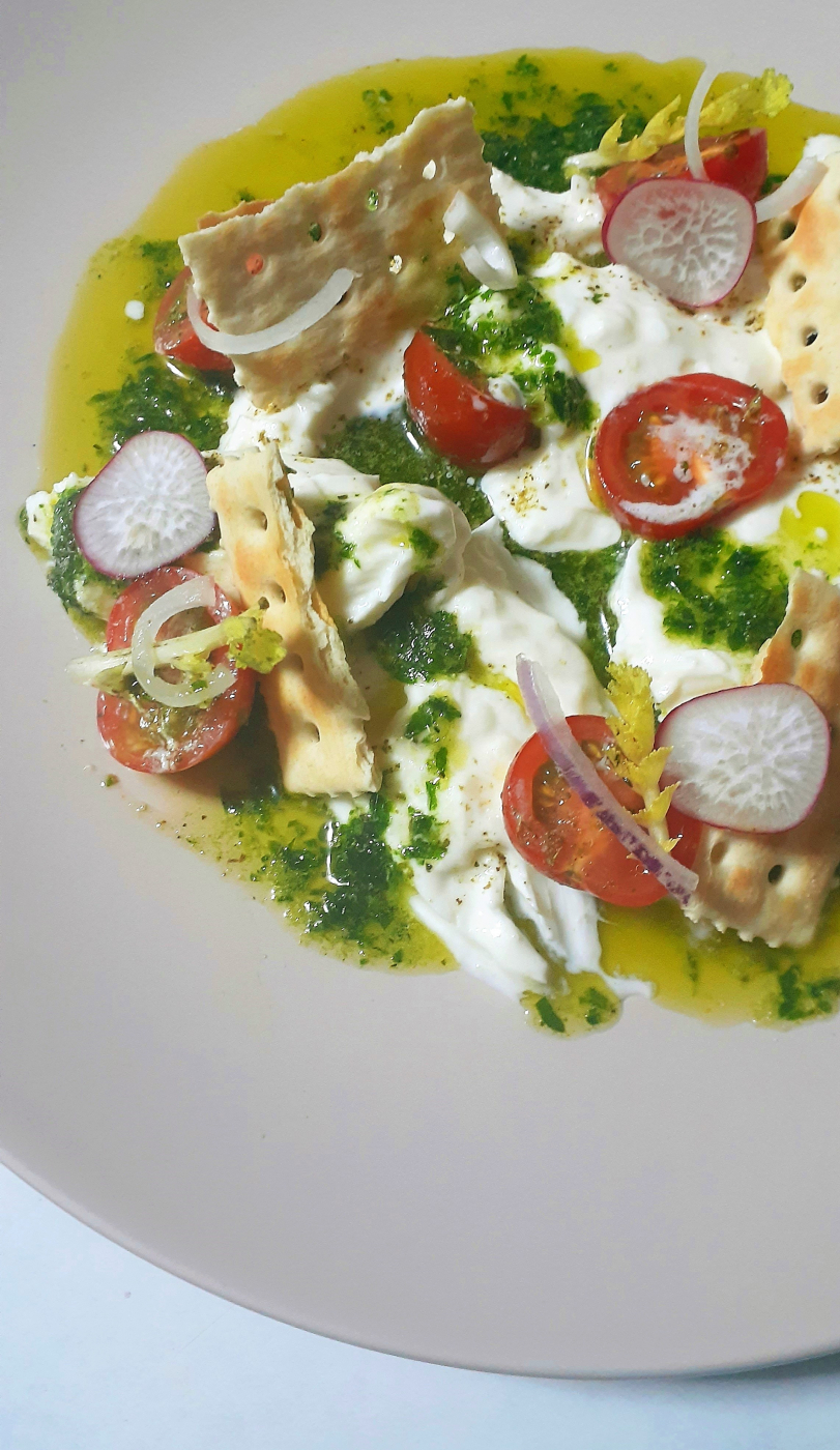 Green pesto, smoked burrata, tomatoes, and red onions