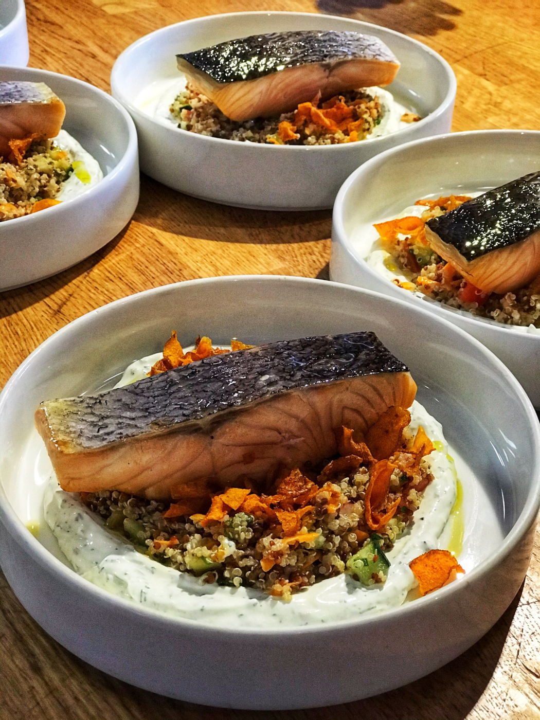 Fried salmon over quinoa taboulé and dill labaneh