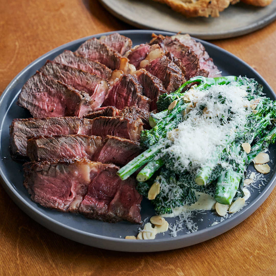 Grass-fed Irish Cote De Boeuf with almond caesar salad, beef dripping toast