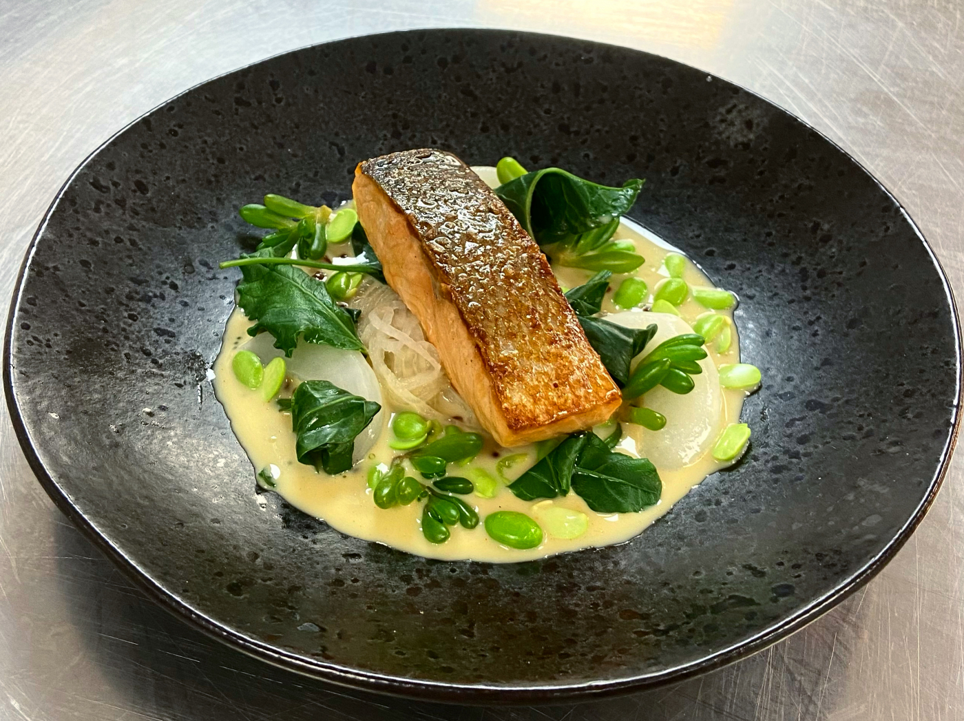 Loch duart salmon, oyster and wasabi sauce, sake and mirin mooli, turnip, edamame beans and sea vegetables