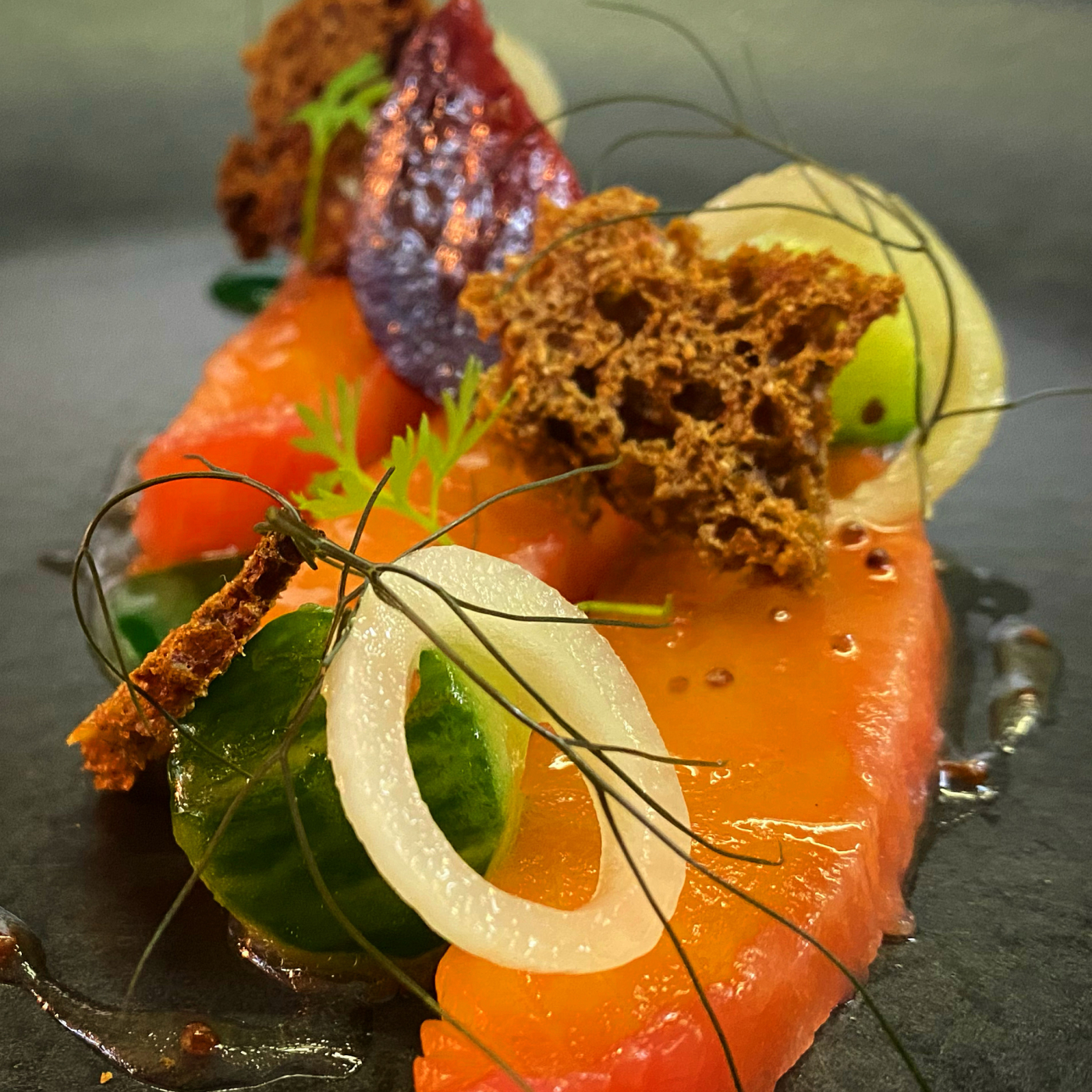 Festive starter  Beetroot cured salmon, pickled shallots, compressed cucumber, walnut, treacle