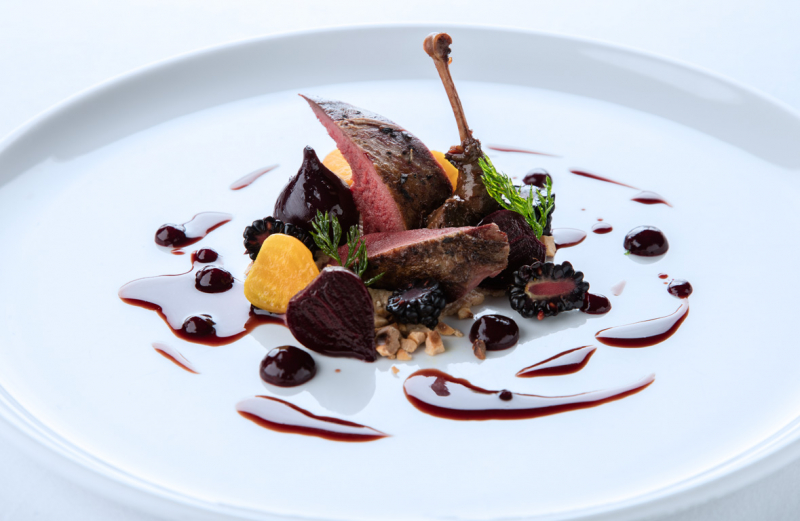 Pigeon roasted on the bone, braised and glazed leg, beetroot, hazelnuts and brambles