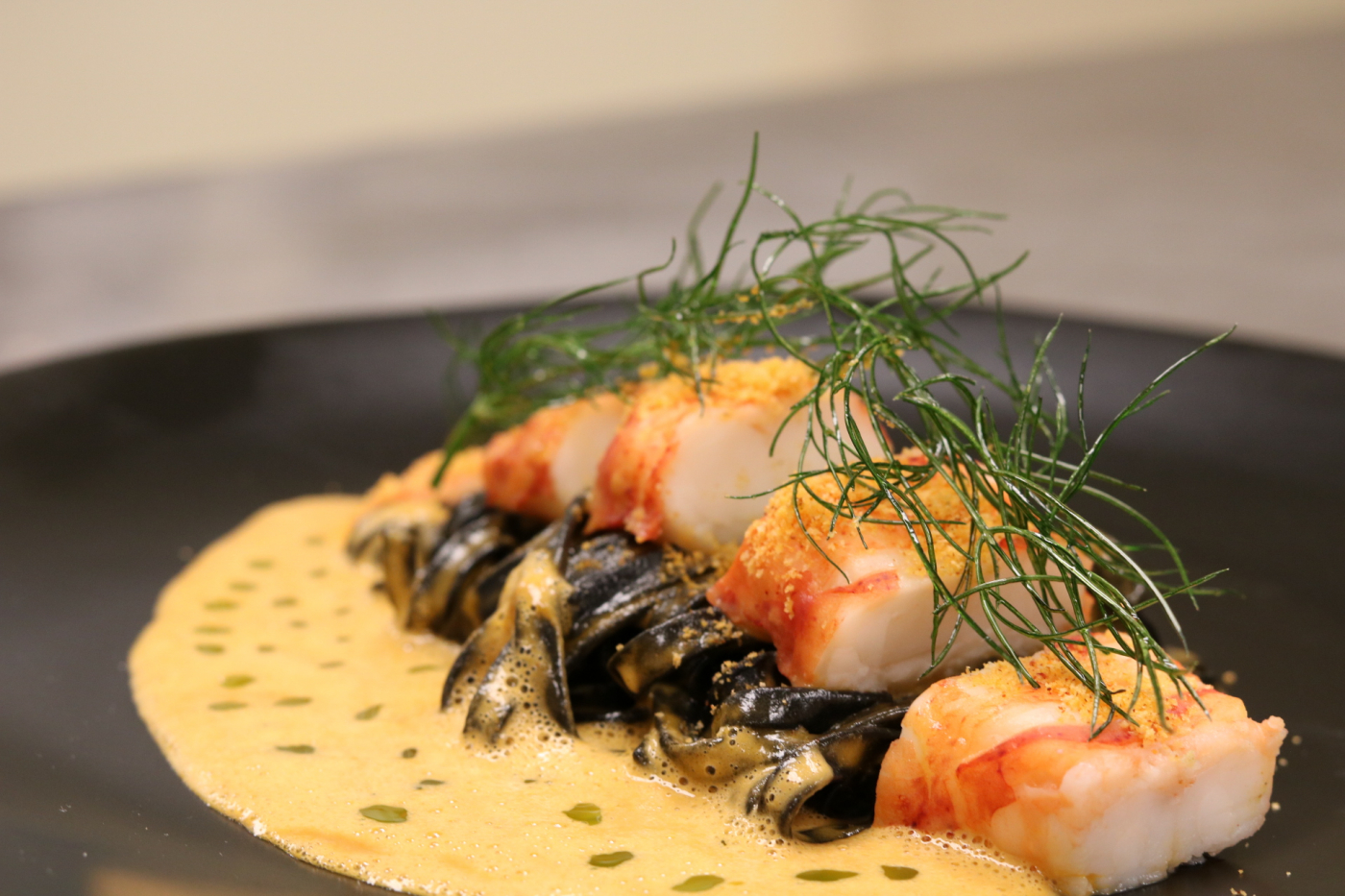 Squid ink Pasta ChitarraSlow cook 57c lobster TailAnise Crisp + Oil