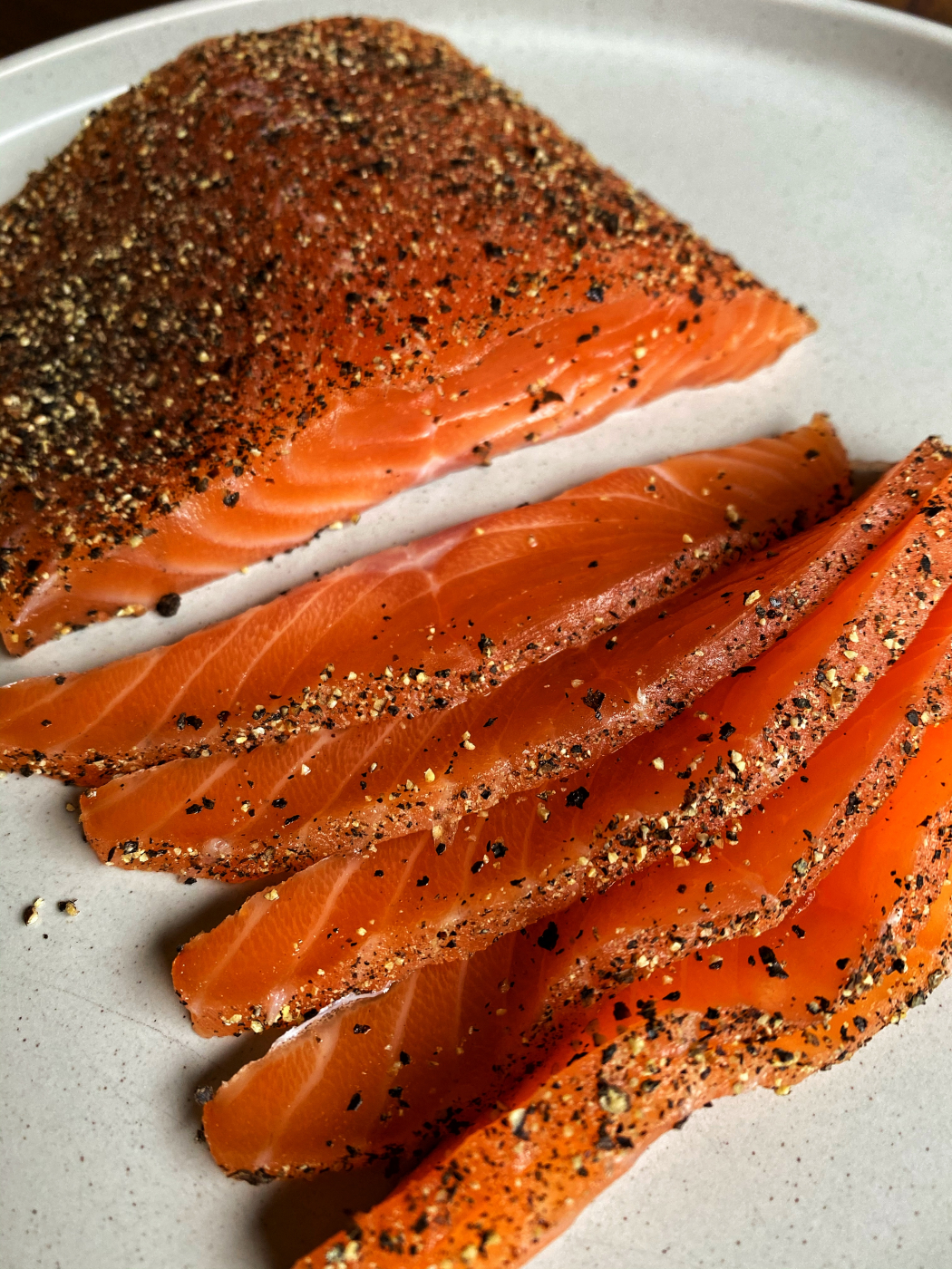 simple salmon pastrami. Scottish Salmon cured for three days , smoked with hickory. Coated well with freshly ground black pepper.