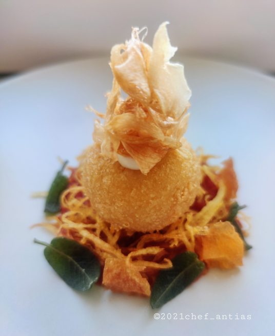 """Pallotta cacio e ova"", potato nest, crispy sage and Sulmona garlic crisps."
