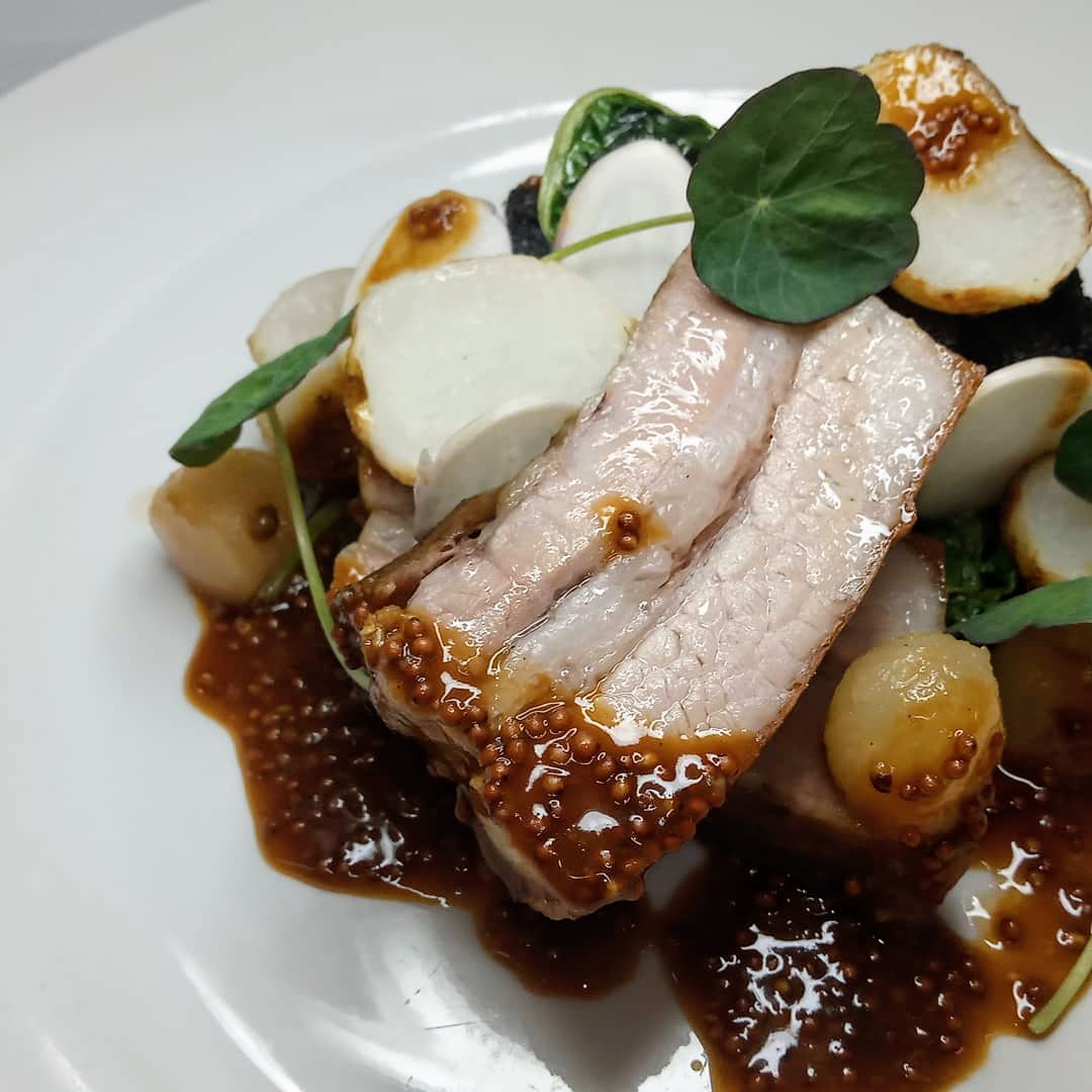 Twice cooked pork belly, blackpudding and apple terrine, pickled apple, roasted baby turnip.