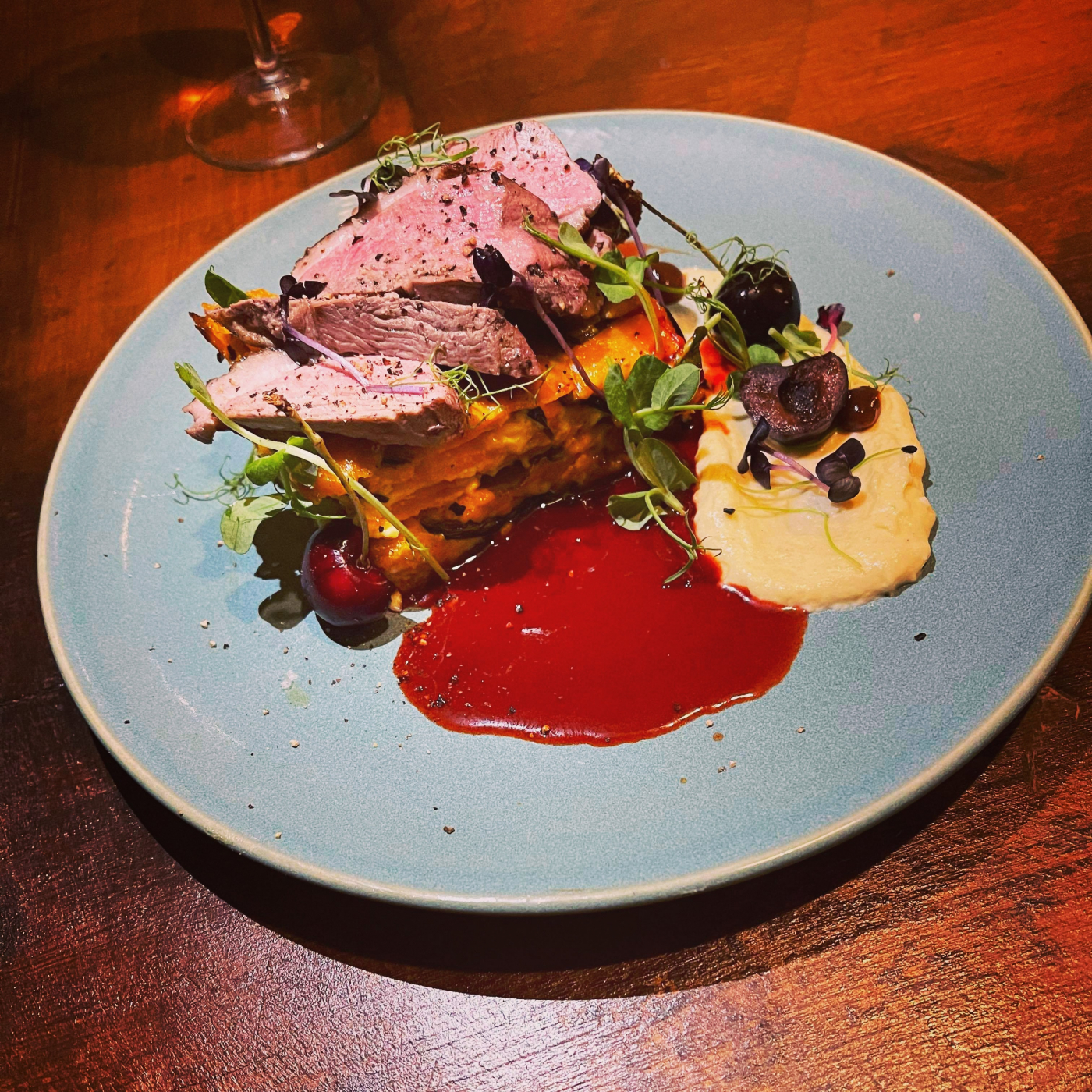 Coffee rubbed duck breast, oatmeal, parsnips and vanilla purree, sweet potato pave, Maraschino jus.