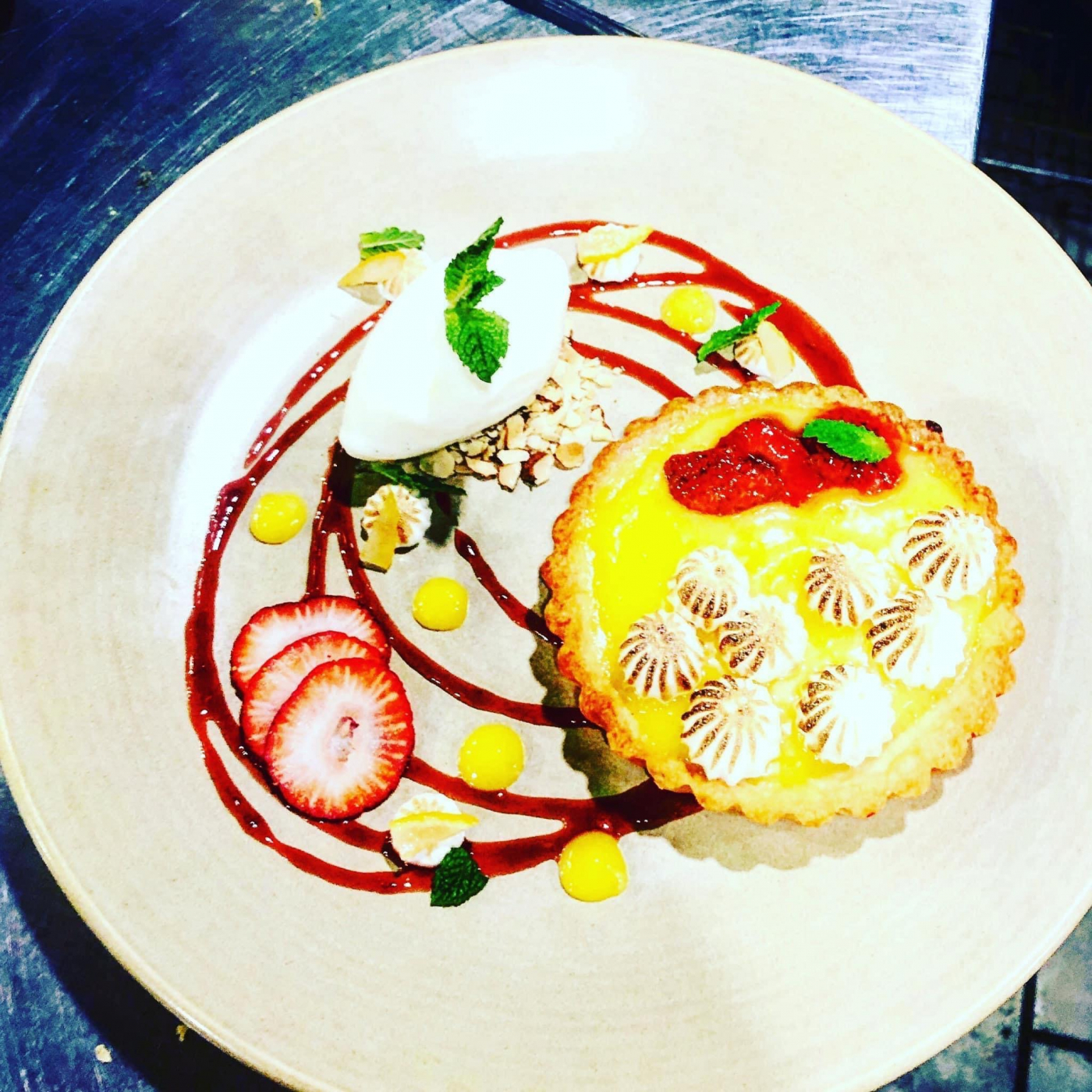 Lemon meringue tart, confit strawberry, buttermilk sorbet, almond crumble, candied lemon rind, strawberry gel