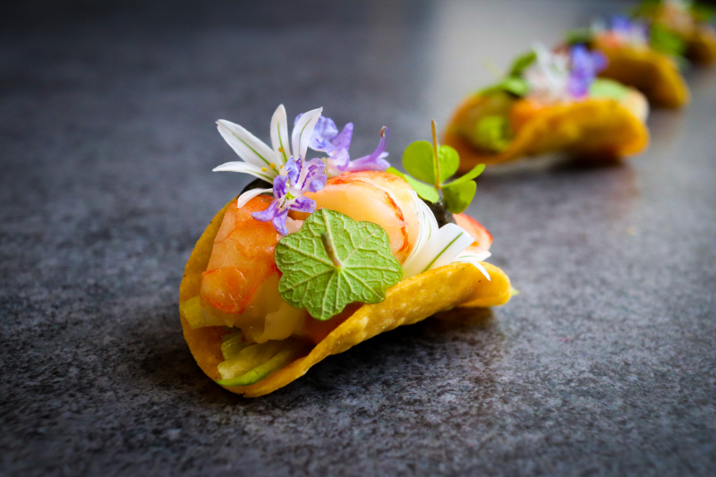 Prawn Cocktail... Taco 🌮  Take a classic, and turn it into a taco 😂 Poached prawns, Bloody Mary Rose, Black Garlic aioli, iceberg, mini maize taco, wild garlic flowers and garden greens herb 🌿