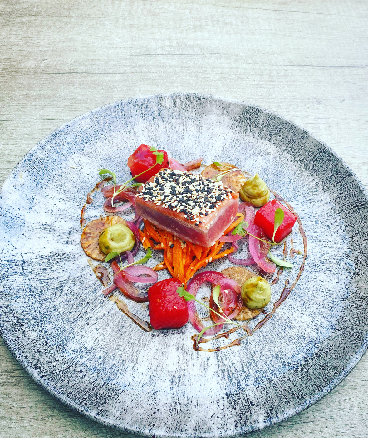 Sesame seared tuna, carrot & ginger slaw, soy marinated mouli compressed watermelon, avocado purée, pink onions