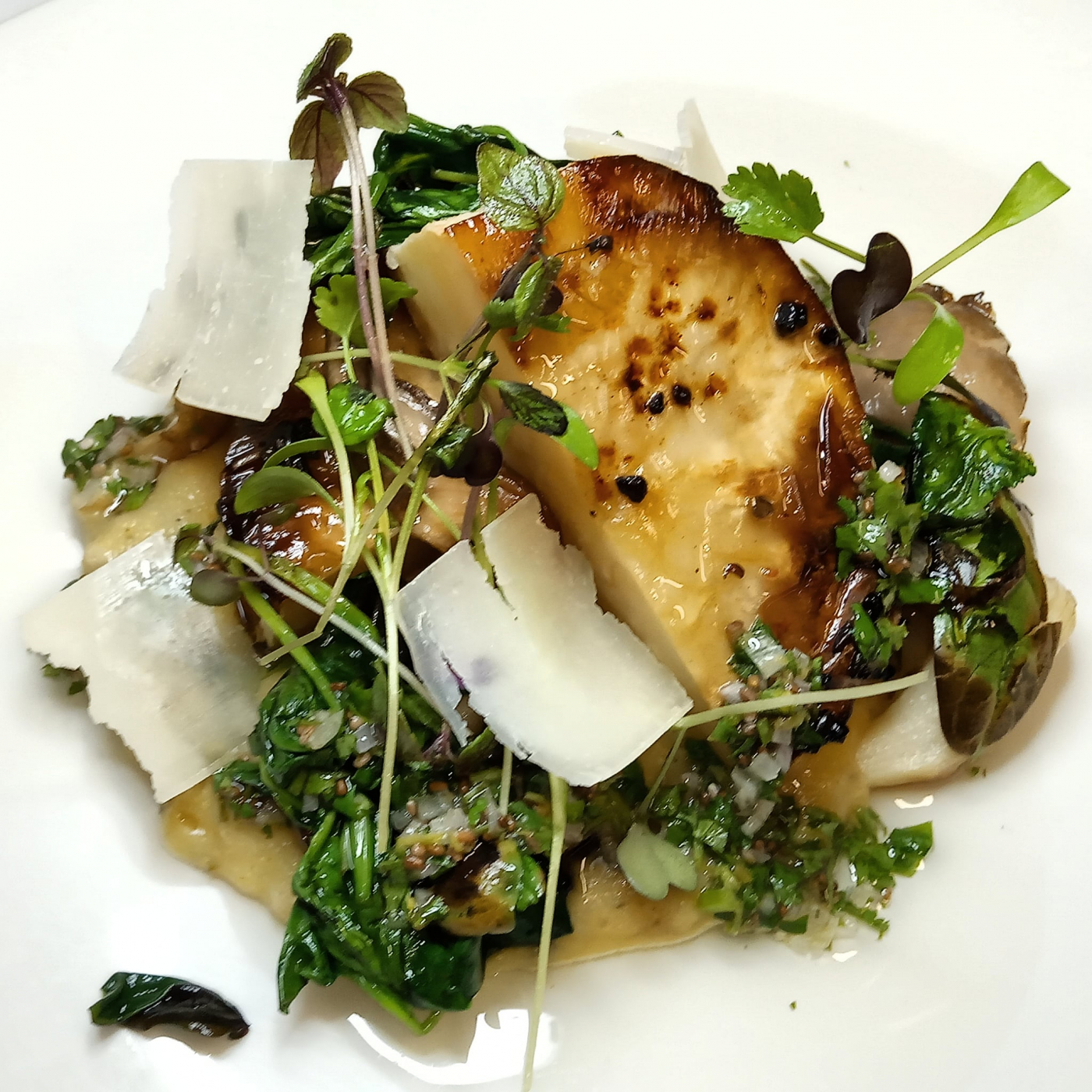 Celeriac slow roasted in garlic and herbs, black truffle polenta, forest mushrooms, gremolata, shaved parmesan