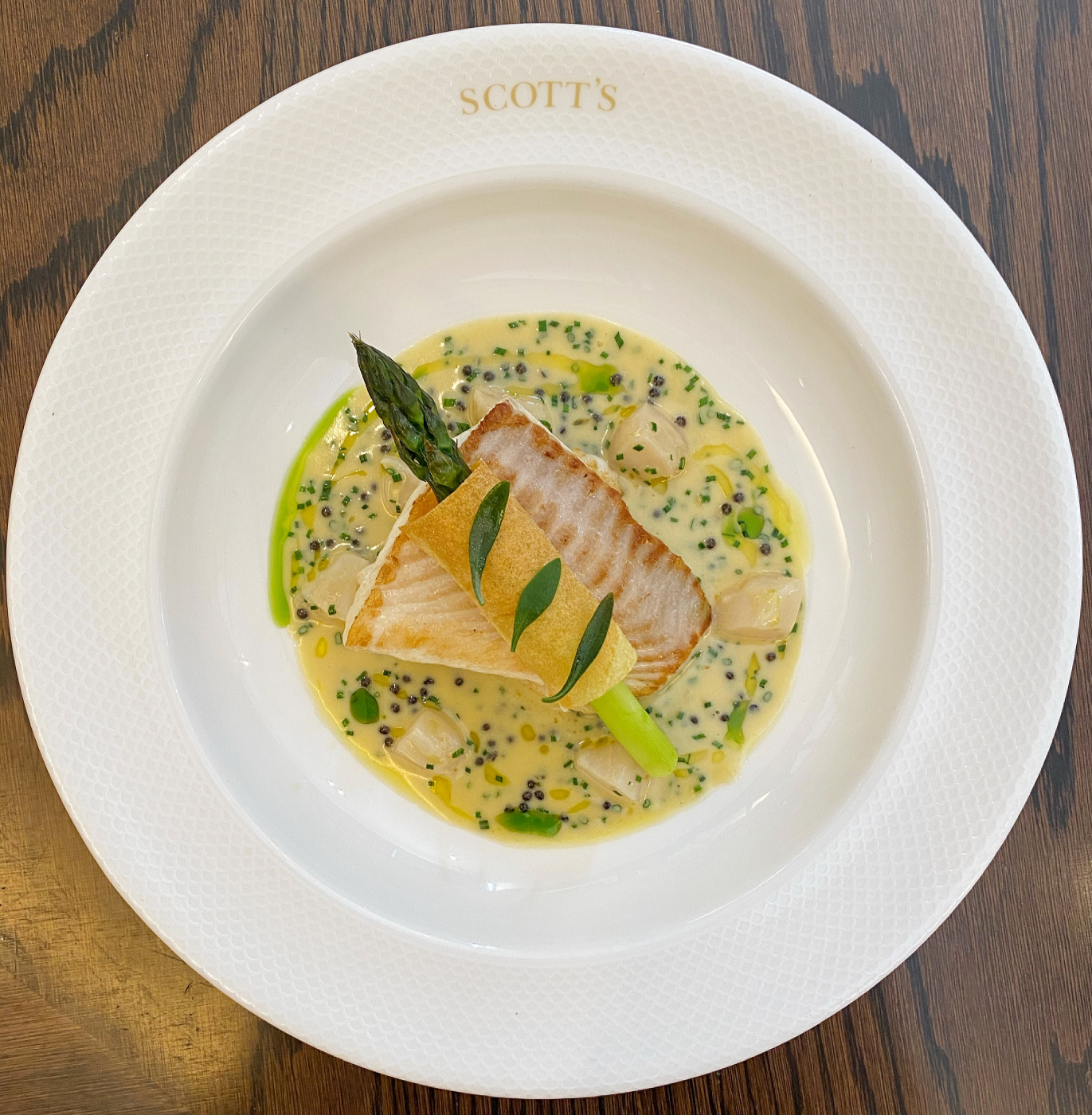 Fillet of turbot, asparagus, scallop and caviar veloute