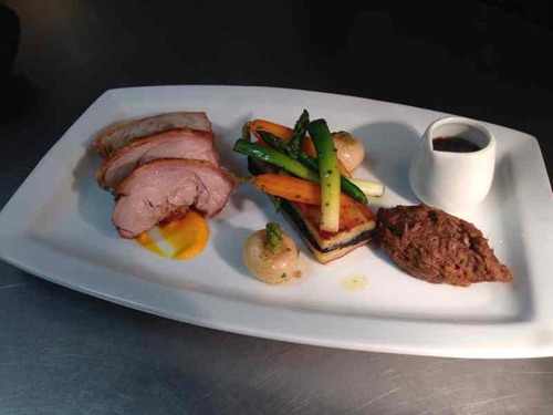 Suckling pig, potato and black pudding terrine, spring veg, pulled pork and pork jus