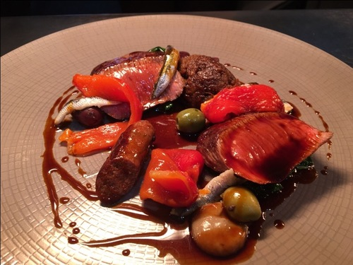 Barnsley end of lamb, Merguez sausage, anchovy, roasted peppers, olive and gentleman a relish.