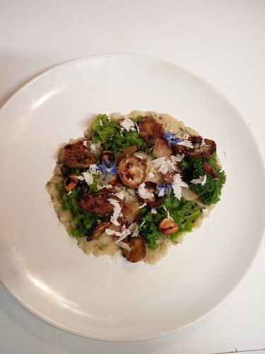 Jerusalem artichoke done 3 ways pureed, fried, steamed with kale, fried garlic,  parmesan shavings, molasses and borage flowers