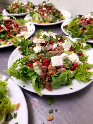 Warm shredded duck pomegranate, pine nuts, and feta salad for the boom club today.