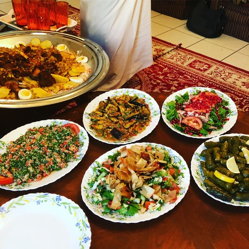#Dubai lunch today Curried goat and rice and incredible salads :stuck_out_tongue_winking_eye::flag_ae: