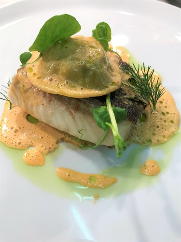 Halibut, crab ravioli, shellfish veloute, parsley,