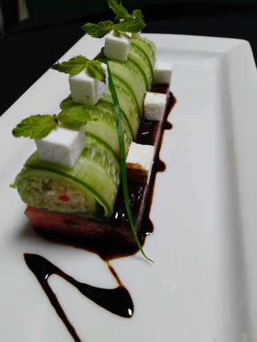 Stuffed picked cucumber with kotoyaki cous cous on the bed of melon