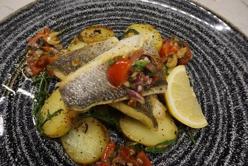 Sea bass, sauteed potato ,sanphere ,tomatoes olive