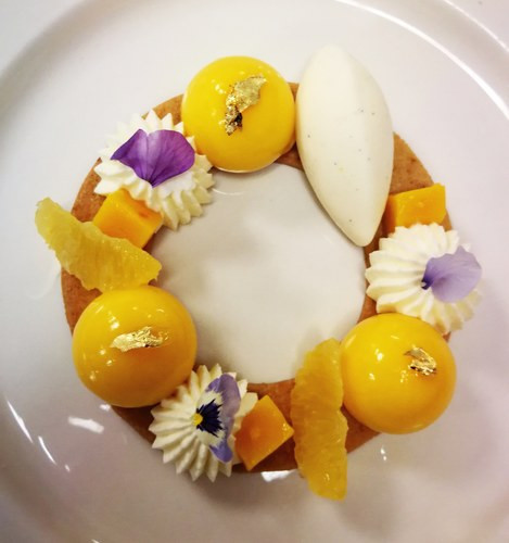 Last creation. Tropical dessert. Passion fruit mousse, exotic jelly, orange segments, coconut chantilly, orange sable, vanilla ice cream