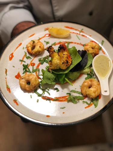 Coconut, Ginger & garlic marinated Tandoori King Prawns served with coconut chutney