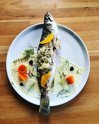 Grilled trout, cauliflower purée , orange infused carrots shaved fennel and caviar .