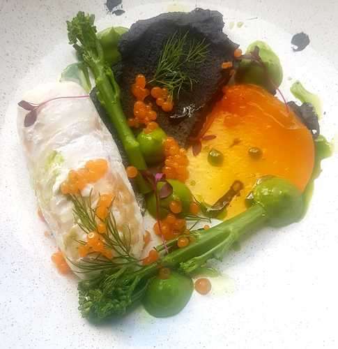 "Sous vide hake, squid ink mash, tenderstem broccoli, orange ""caviar"", dill oil."