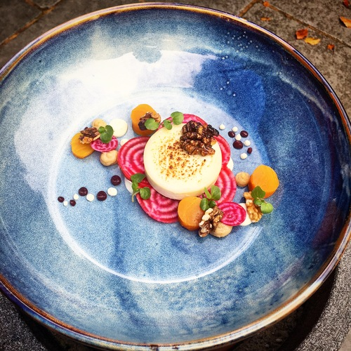 Torched and whipped goats cheese, honey and whiskey poached beets, pickled beets, walnut cream