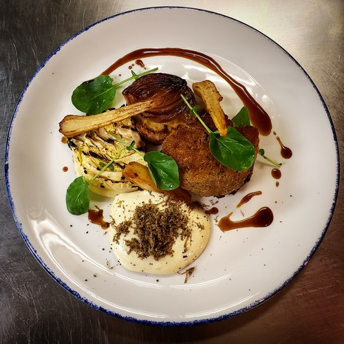 Foie gras crusted beef tenderloin, celeriac fondant, grilled cabbage, brown butter + truffle hollandaise