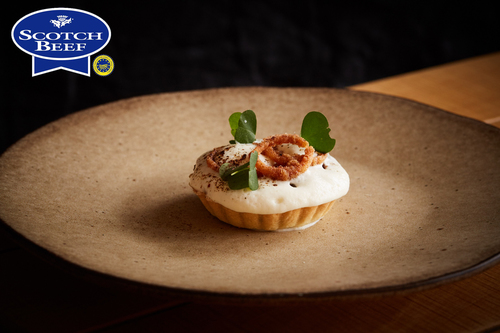 Braised Scotch Beef Cheek Tart, horseradish & crispy onions by Jamie Scott