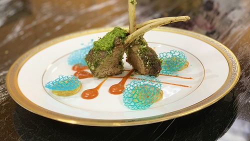 Lamb chops, pistachio crust and red pepper sauce