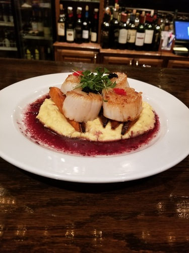 Seared scallop, charred carrots, bacon parm polenta, red wine reduction