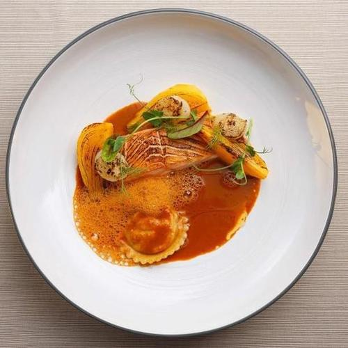 Torched Scottish salmon, lobster ravioli, oranges scented fennel, lobster bisque