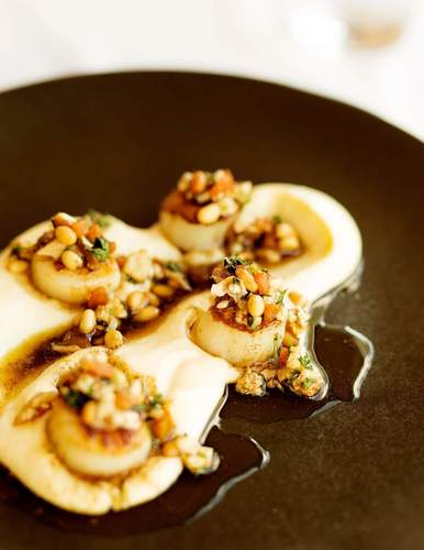 Scollops ,cauliflour puree and pinenuts