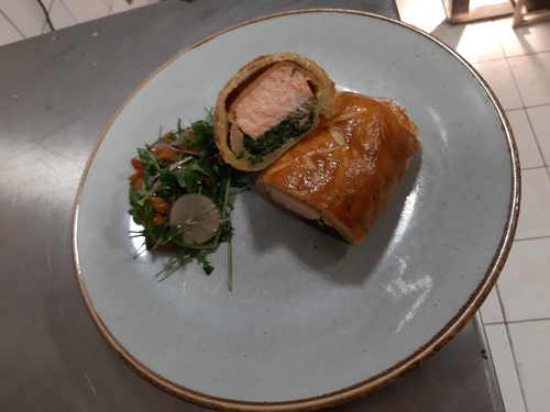 Salmon wellington with spinach and onion.