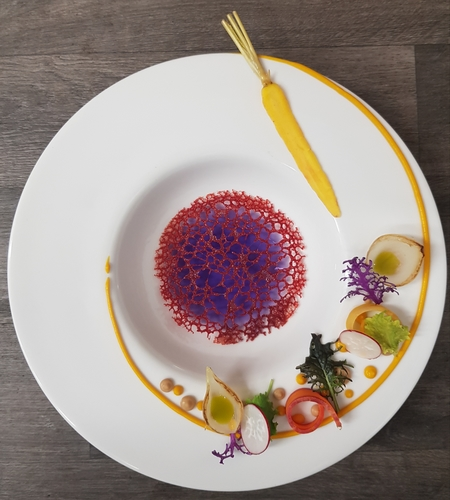 Purple carrot consommé, heritage carrot, caramelized onion, carrot top oil