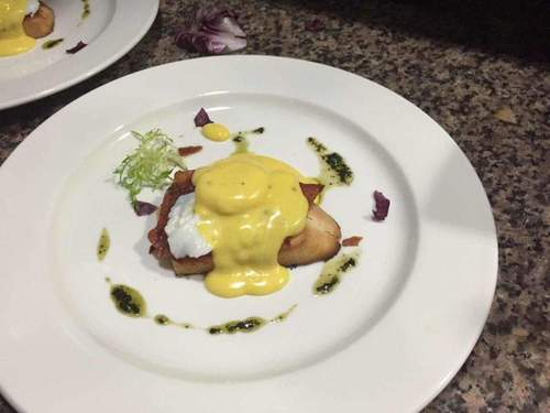 Egg Benedict with French bread Hollandaise sauce on top