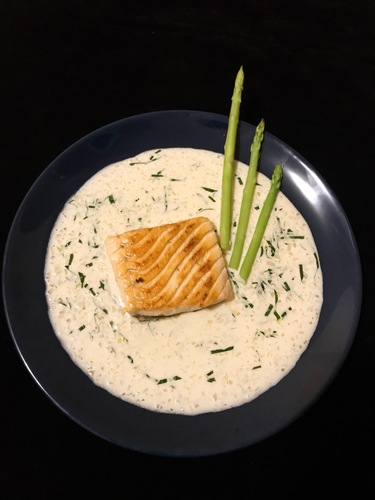 Dry fried salmon, asparagus and creamy sauce with basil