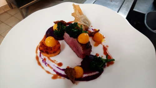 Roast duck breast, red cabbage puree, clazed turnips, sweat potato fondont, brasied duck leg wonton.