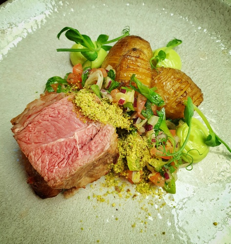 Welsh lamb rump, confit lamb belly, hasselback jersey royals, spring onion salsa, wild garlic mayo, pistachio. Spring on a plate