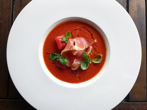 Chilled watermelon, charred pepper & chilli soup, Serrano ham, basil