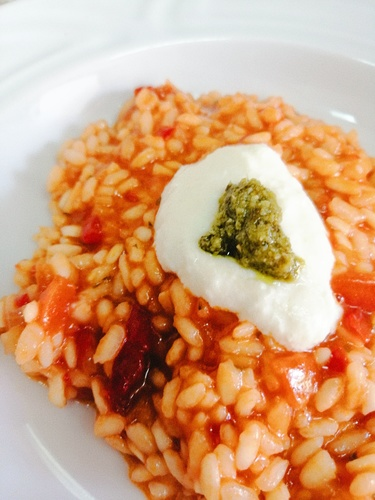 Sea food risotto with cheese ice cream and homemade pesto genovese