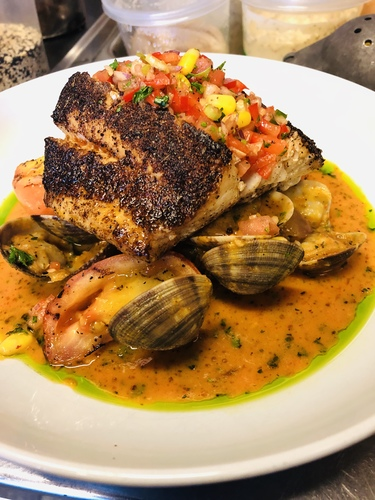 Blackened lingcod and Cajun clams, cajun/corn salsa