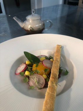 Venison tartare, smoked game consommé, rapeseed mayonnaise, slow cooked hens egg yolk, thyme biscuit, nasturtium