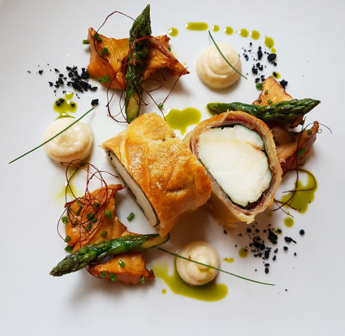 'Monkfish Wellington'  Part. 3 Monkfish tail marinated with thyme in puff pastry/prosciutto and spinach•cauliflower puree•butter sear chanterelles•asparagus•chive oil...