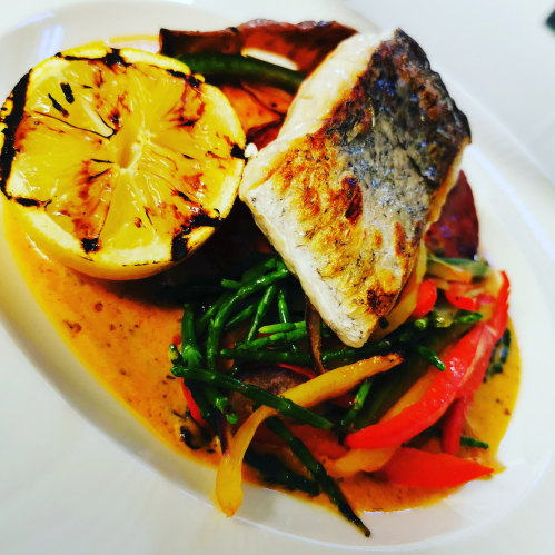 Catch of the day hake,chorizo,peppers and samphire, sweet potato wedges and a whiskey creole sauce