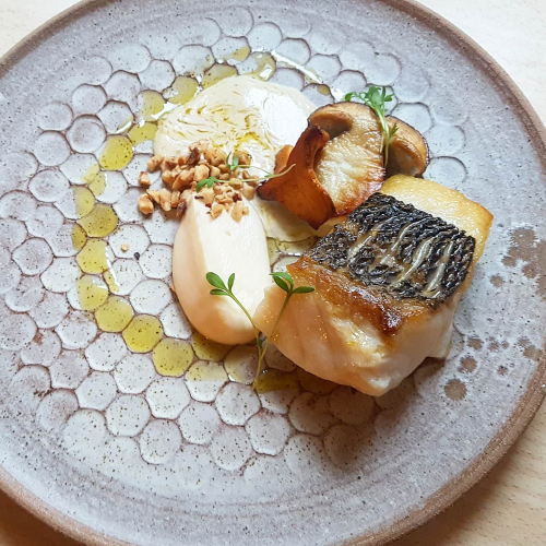 Sea bass•cauliflower puree•hazelnut•buttered mushrooms•fish and leek velouté•olive oil... • #tbt Plate by @gpointceramics