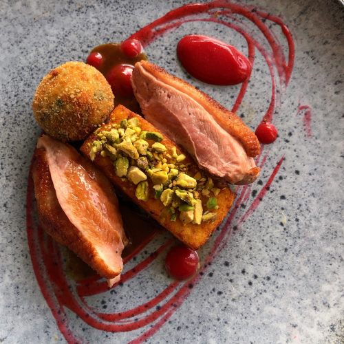 Duck Breast/Plum Purée/Parmesan-Spinach Croquette/Fried Polenta/Toasted Pistachio Crumb/Duck-Five Spice Jus